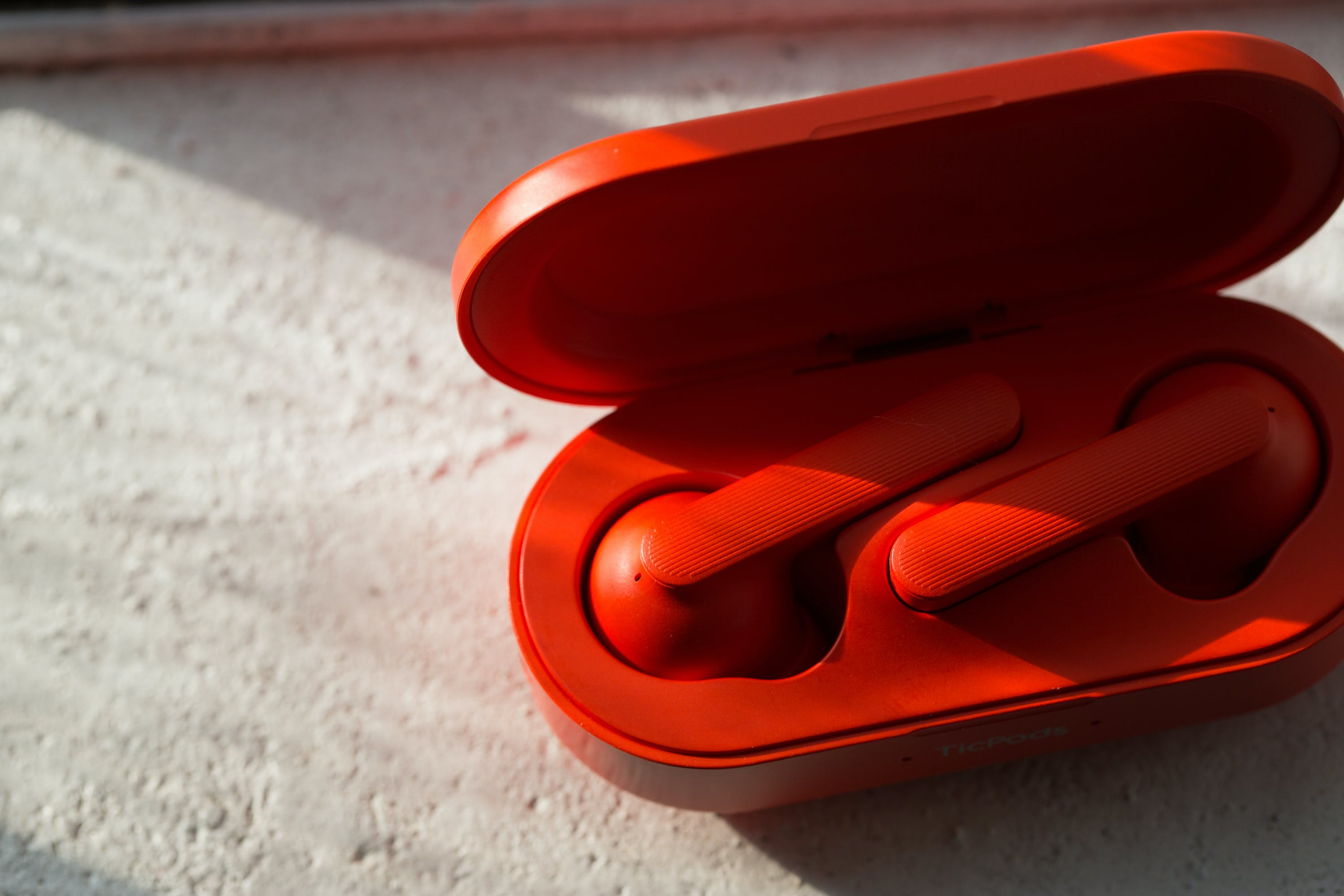 Copy of red ticpods with case.jpg?ixlib=rails 2.1